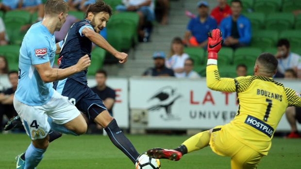 Target practice: Milos Ninkovic takes a shot at goal during a busy night for Dean Bouzanis.