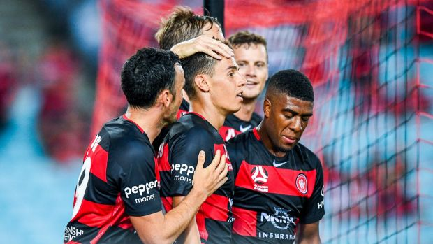 Welcome to the Wanderers: Christopher Ikonomidis is congratulated by his new teammates after turning on something ...