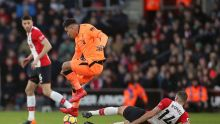 Liverpool's Roberto Firmino and Southampton's Oriol Romeu, right, battle for the ball during the English Premier League ...