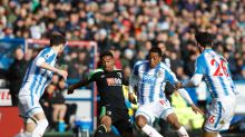 AFC Bournemouth's Jordon Ibe, center left, and Huddersfield Town's Rajiv van La Parra battle for the ball during their ...