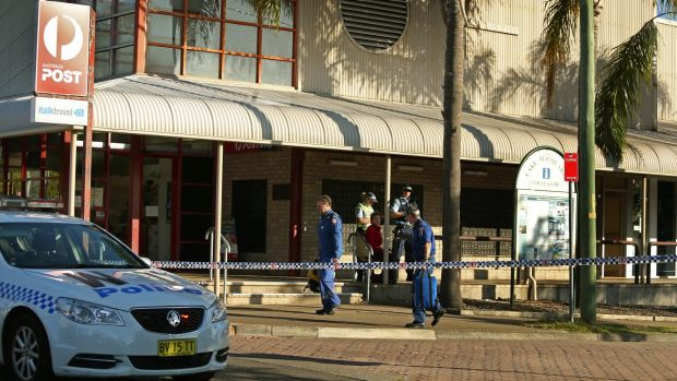 Police at the scene of the shooting outside Warners Bay post office.