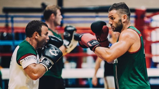 Boxer Dave Toussaint takes Robbie Farah through a session at the AIS in January.