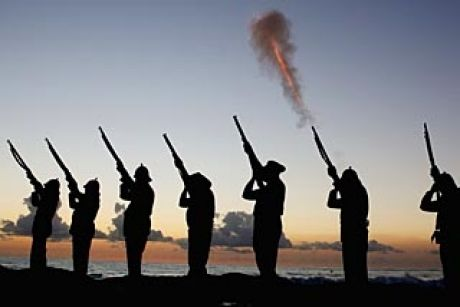 Members of the Albert Battery shoot a volley of fire during the ANZAC dawn service.