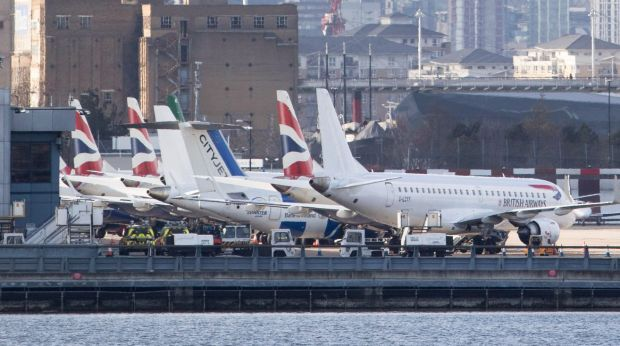 Passenger aircraft sit grounded on the tarmac at London City Airport, following the discovery of an unexploded bomb, in ...