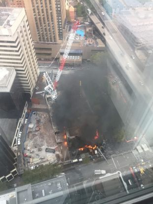 Black smoke billowed from the fire at Circular Quay.