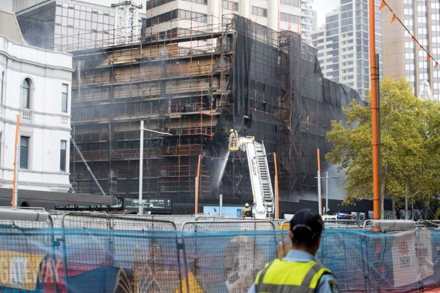 Firefighters extinguish the fire in Circular Quay.