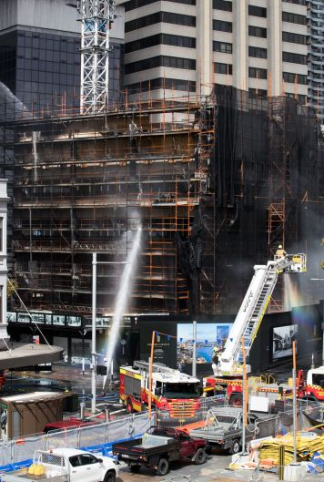 Firefighters extinguish a fire in Circular Quay, Sydney.