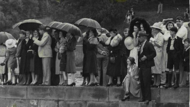 Anxiously awaiting news, crowds stood in pouring rain at Fort Macquarie. Many were relatives of the survivors, and ...