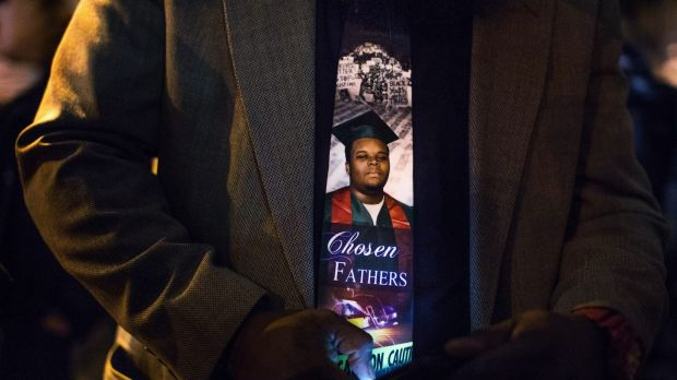 An image of Michael Brown, who was killed by the police in Ferguson, Missouri, on the tie of his father, Michael Brown ...