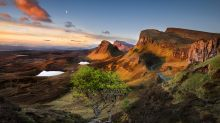 Sunrise over the Quiraing on Skye, a jumble of crags and needles formed by an ancient landslide.