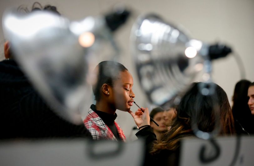 A makeup artist prepares a model backstage for her appearance in the Oscar de la Renta fashion show during Fashion Week ...