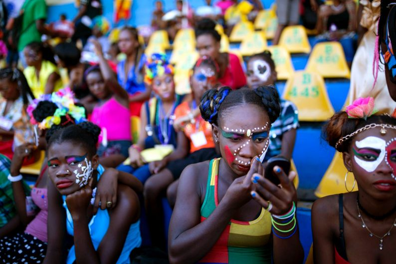 Dancers wait for the start of Carnival celebrations at the National Stadium in Port-au-Prince, Haiti.