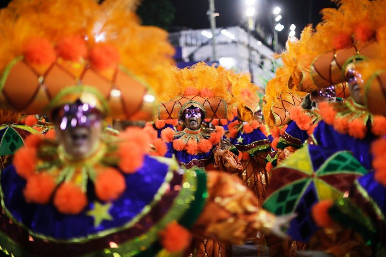 Performers from Academicos do Grande Rio samba school parade during Carnival celebrations at the Sambadrome in Rio de ...