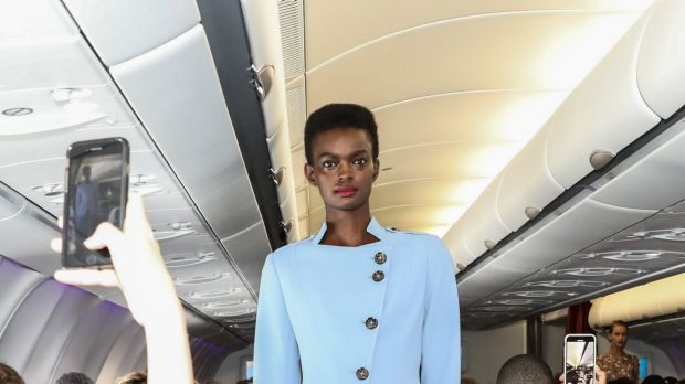 More than 200 paid passengers were on board the flight for the four-minute fashion show.