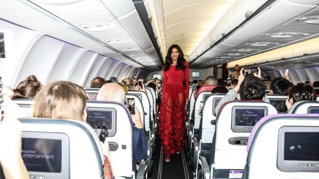 Kelly Gale opens the Runway in the Sky show on board a Virgin Australia plane featuring designs by Australian brand ...