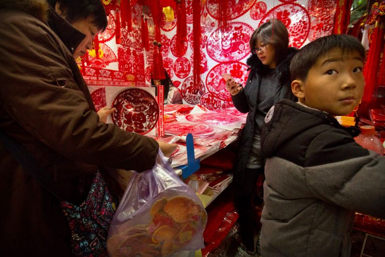 Customers shop for Lunar New Year decorations at a wholesale market in Beijing.