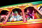 Float riders encourage the crowd as the Krewe of Orpheus rolls in New Orleans, Monday, Feb. 12, 2018. (AP Photo/Gerald ...