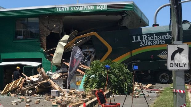 A truck driver has died after crashing into the Tentworld c&ing shop at Windsor. & Driver dies after after garbage truck crashes into Brisbane tent store