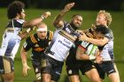 The Brumbies' Tevita Kuridrani and Joe Powell make a desperate tackle on Chiefs winger Solomon Alaimalo.
