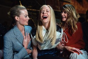 Margot Robbie, Nicole Kidman, and Laura Dern laugh during the Calvin Klein fashion show at the Fashion Week in New York.
