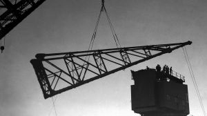 The floating crane, The Titan, lowers the jib for the Garden Island crane on 27 October 1941. SMH NEWS Picture by GORDON ...
