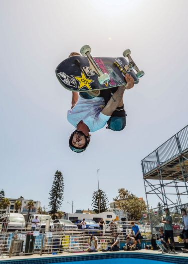 Bucky Lasek one of the pro skaters warming up with an Indy Air at Bowl-A-Rama.