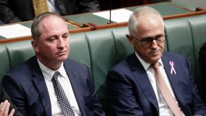 Deputy Prime Minister Barnaby Joyce and Prime Minister Malcolm Turnbull sit together during a division as Labor moves to ...