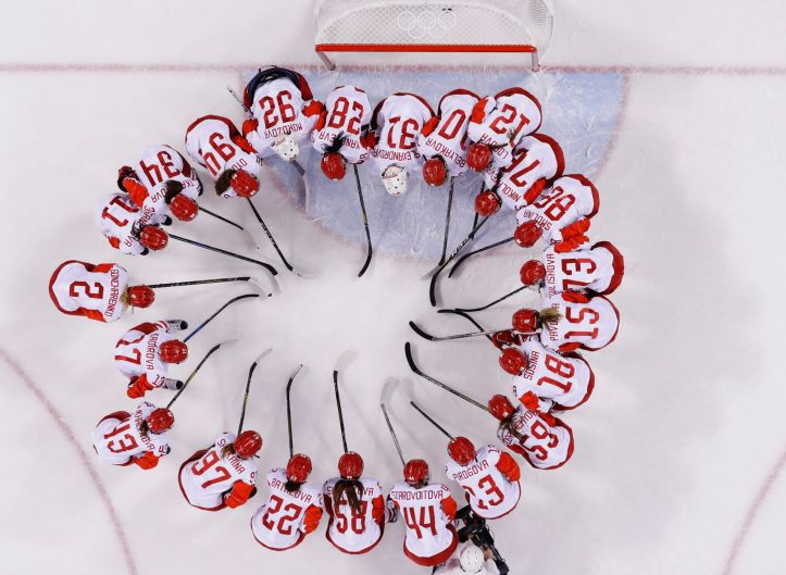 Russian athlete Nadezhda Morozova (92) huddles with teammates after the quarterfinal round of the women's hockey game ...