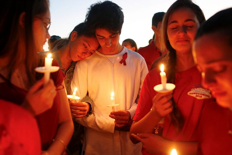 Students gather during a vigil at Pine Trails Park for the victims of Wednesday's shooting at Marjory Stoneman Douglas ...