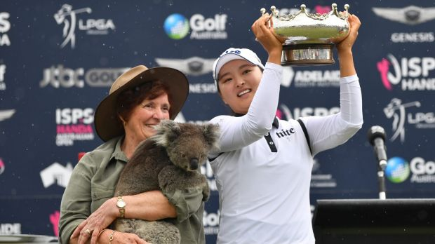 Bearing up well: Jin Young Ko celebrates with her trophy, and 'Honey' the koala (held by Rae Campbell), after winning ...