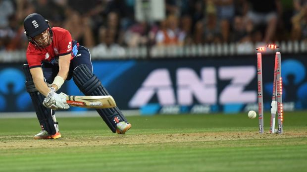 England's Sam Billings scoops the ball on to his stumps against New Zealand at Seddon Park on Sunday.