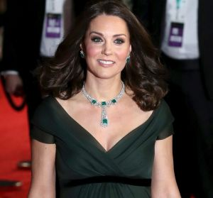 Catherine, the Duchess of Cambridge, arrives at the BAFTA awards wearing a dark green gown by Jenny Packham.