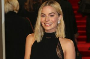 Margot Robbie poses for photographers upon arrival at the BAFTA Awards.