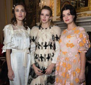 Alexa Chung, Greta Bellamacina and Pixie Geldof pose for photographers before the Simone Rocha Autumn/Winter 2018 ...