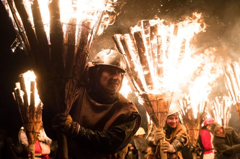 "A man holding a burning briar during the torchlight procession called ""Chienbaese"" on Sunday evening in Liestal, near ..."