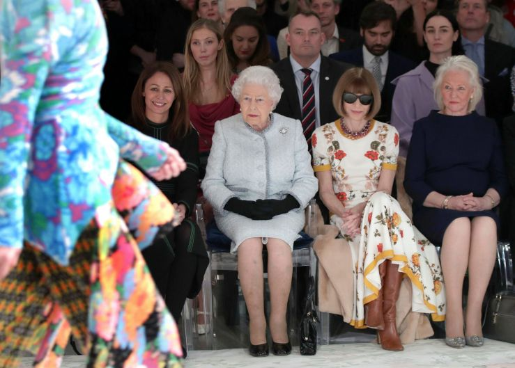 Britain's Queen Elizabeth, second left, sits next to fashion editor Anna Wintour, second right, and Caroline Rush, chief ...