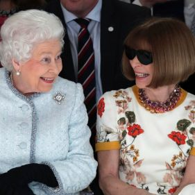 Queen Elizabeth sits next to fashion editor Anna Wintour during a show at London Fashion Week.