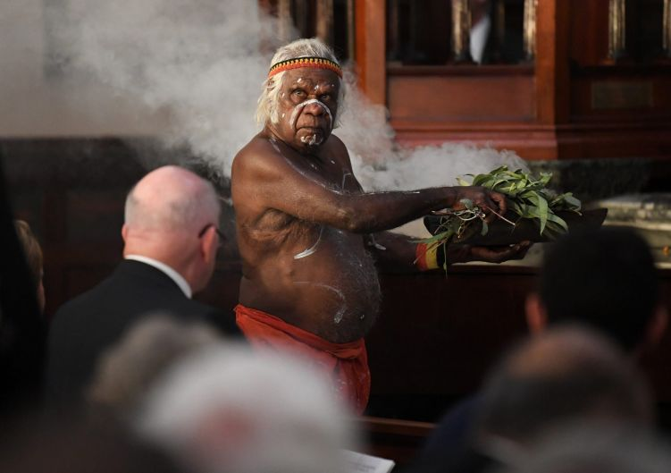 A smoking ceremony is performed before the state funeral.