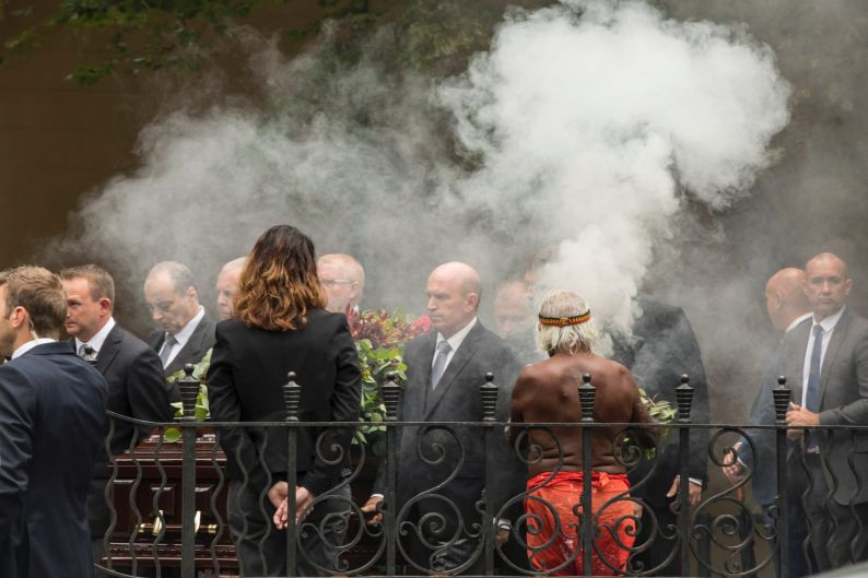 Sir Nicholas Shehadie's coffin is walked into St James Church while Uncle Max performs a smoking ceremony.