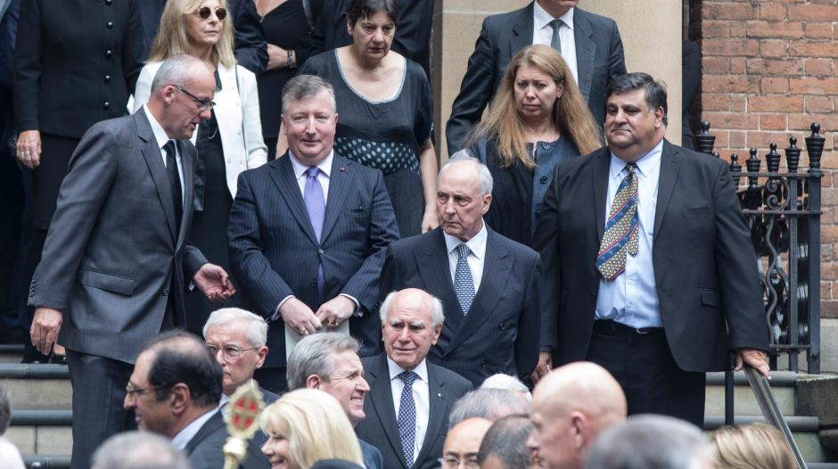 Two former Prime Ministers, John Howard and Paul Keating leave St James Church.
