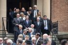 People including two Australian former Prime Ministers, John Howard and Paul Keating leave St James Church after the ...