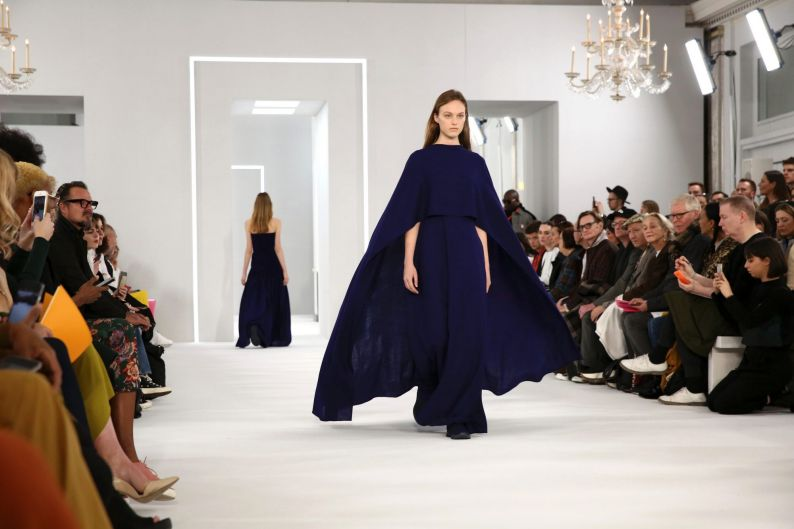 Models wear creations by Jasper Conran at the Autumn/Winter 2018 runway show in London.