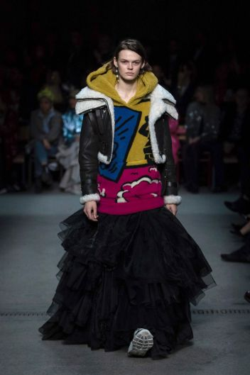 A model wears a creation by designer Burberry at the Autumn/Winter 2018 fashion week runway show in London.