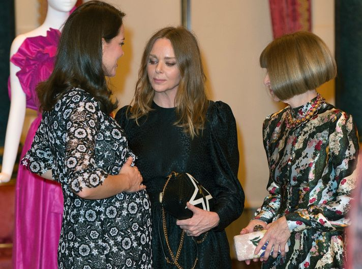 Britain's Kate The Duchess of Cambridge, left, talks with Stella McCartney, centre, and Conde Nast Artistic Director ...