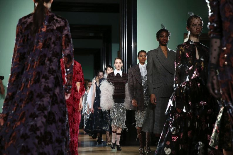Models wear creations by Erdem at the Autumn/Winter 2018 runway show in London.