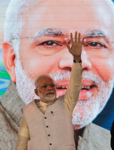 Indian Prime Minister Narendra Modi waves as he arrives to attend the groundbreaking ceremony of Navi Mumbai ...
