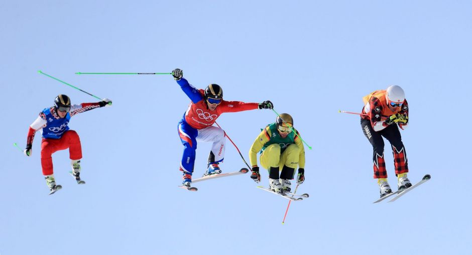 Canada's Dave Duncan (right) leads over the last jump to win his heat in the Men's Ski Cross at the Phoenix Snow Park ...