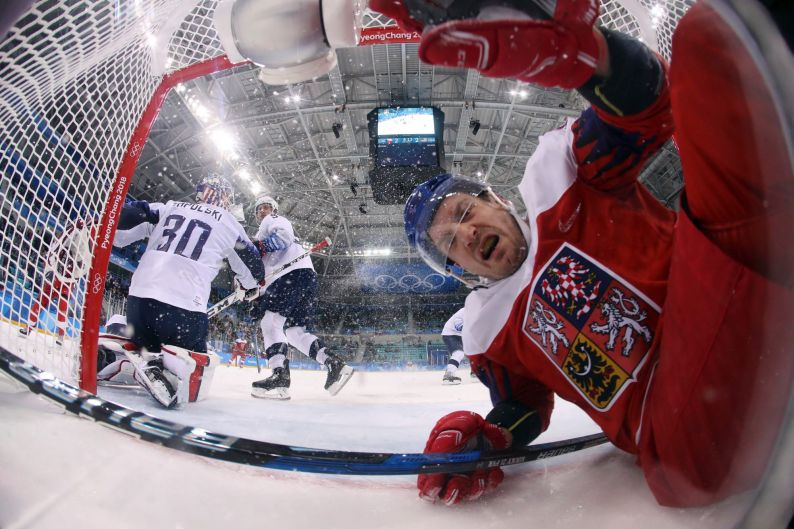 Petr Koukal (42), of the Czech Republic, falls into the goal during the third period of the quarterfinal round of the ...
