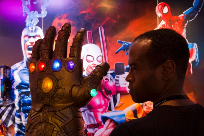 Rafael Jordan models the Infinity Gauntlet from Hasbro, Tuesday, Feb. 20, 2018, at the Toy Fair in New York. The ...