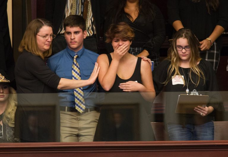 Sheryl Acquarola, a 16 year-old junior from Marjory Stoneman Douglas High School is overcome with emotion in the east ...